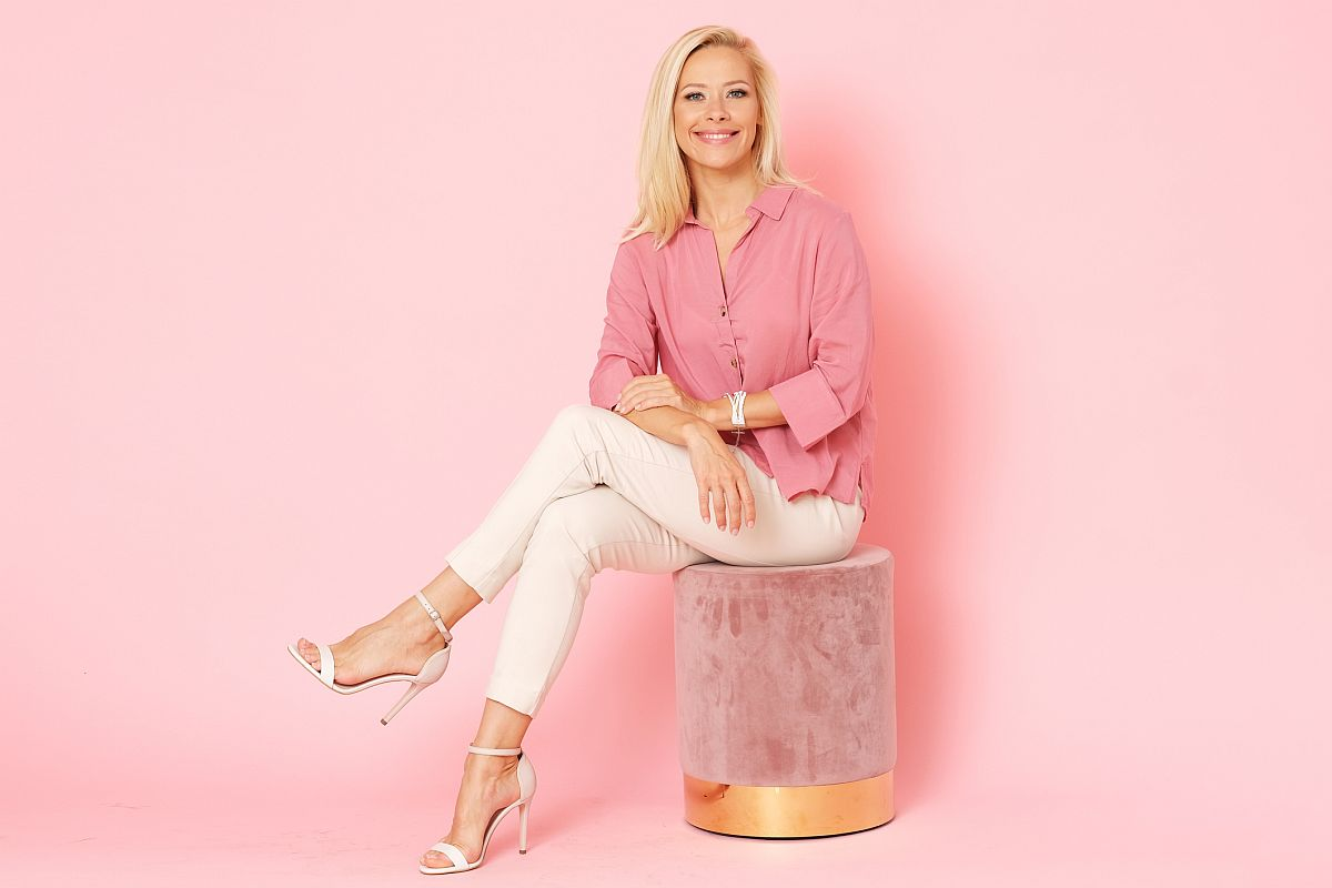 Happy woman in pink shirt isolated on pink background.